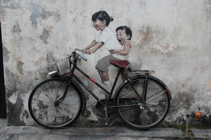 Famous street art - the kids on the bike